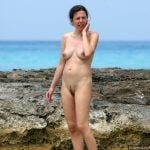 Nudist Woman at Ocean Candid Photo