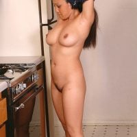 Asian Woman Getting Naked in the Kitchen