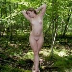 Blonde Female Posing Nude in the Woods