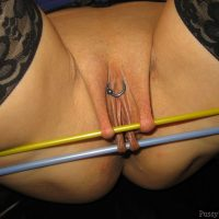 Extreme Piercied Labia Pulling with Sticks