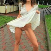 Young Woman Flashing Pussy in Public