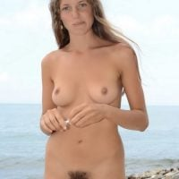 Hairy young Woman Nudism on Beach