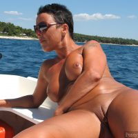 Mature Lady Sunbathing Naked on Lake Boat