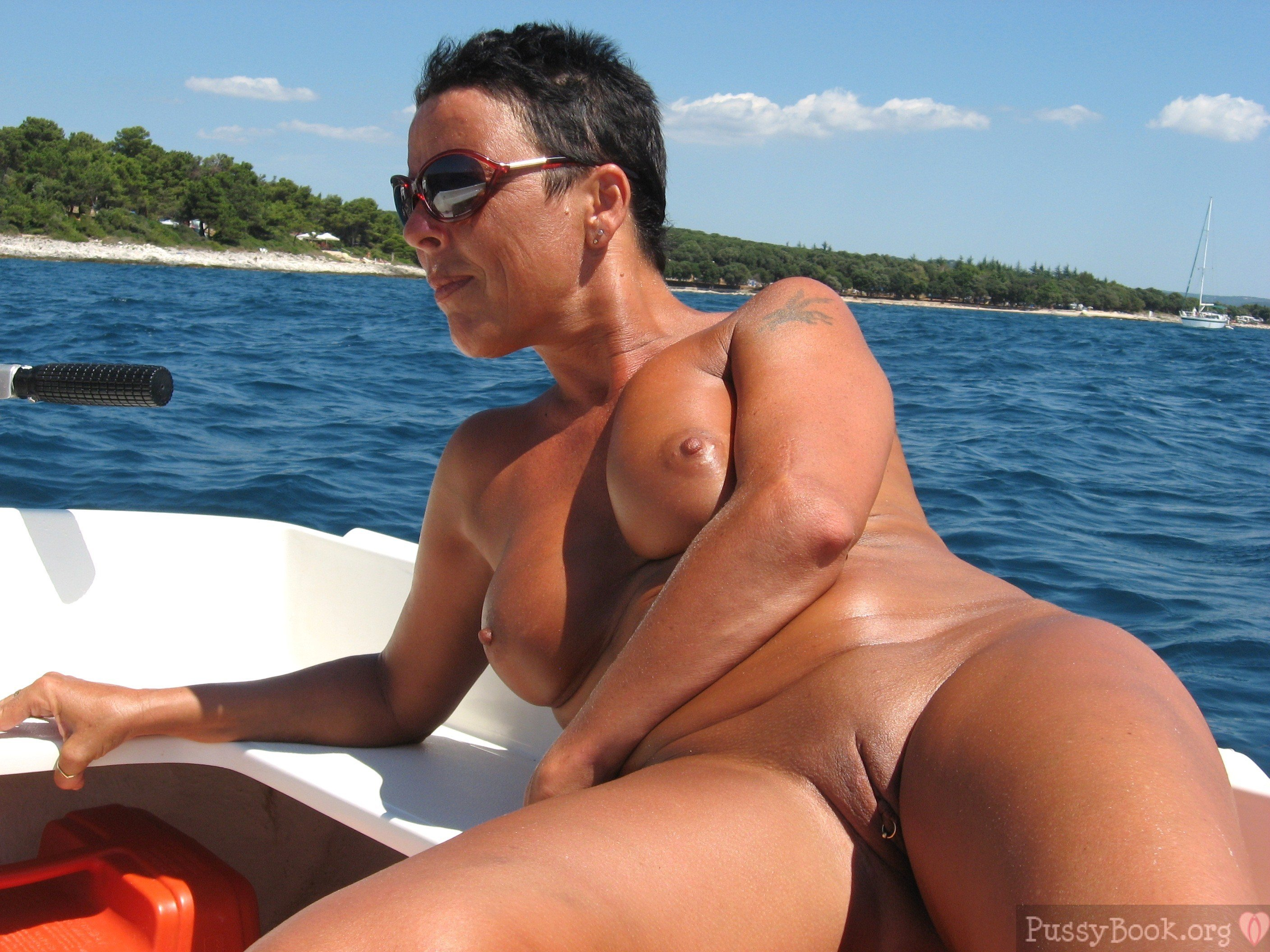 Mature Lady Sunbathing Naked On Lake Boat  Pussy Pictures -6209