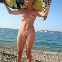 Older Blonde Woman Nudist on Beach