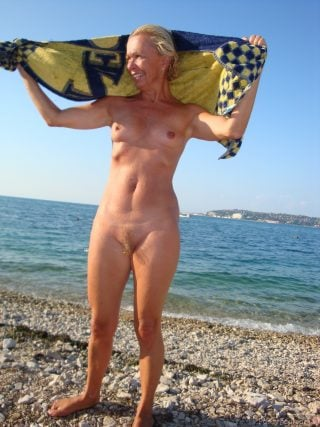Older Blonde Woman Nudist on Beach
