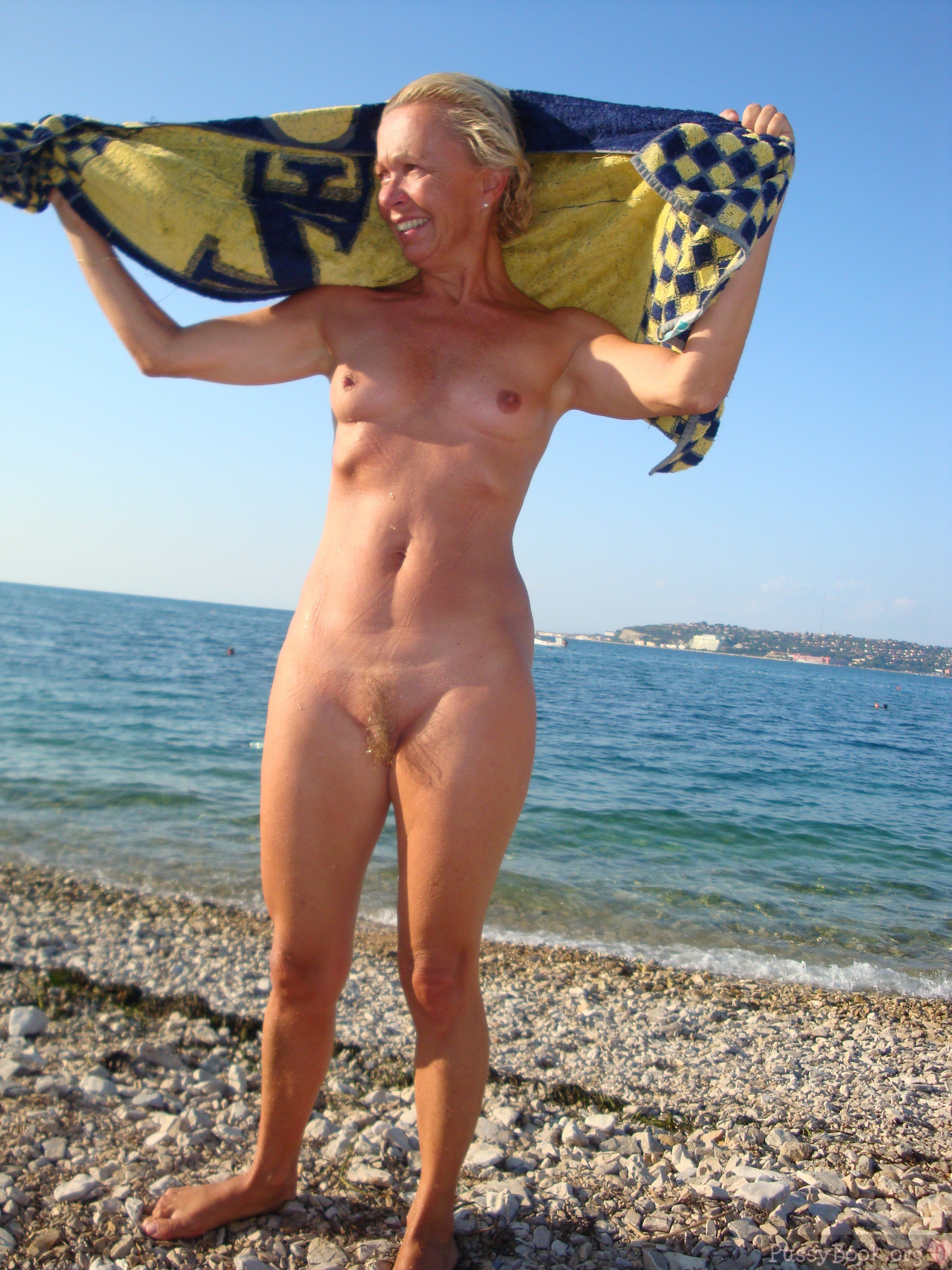Mature woman fucking on nude beach