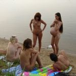 Group of Nudists including pregnant at the Beach