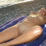 Nudism on Beach Naked Girl Laying Down