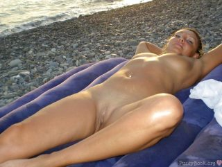 nudism-on-beach-naked-girl-laying-down