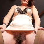 Old Woman Exposing Big Pussy Bush Upskirt