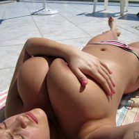 Sunbathing Woman Holding Very Large White Breasts