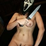 Spooky Masked Nude Girl with Knife for Halloween