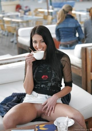 brunette-girl-flashing-pussy-at-the-cafe