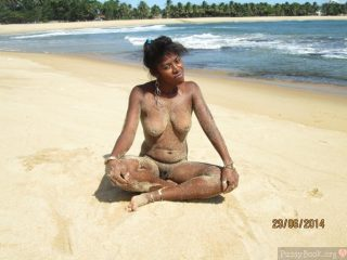 Sandy African Young Nudist Woman