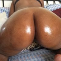 Very Large Brown Shiny Woman Bum