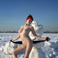 White Naked Girl with Snowman Outdoors
