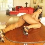 Brown Curvy Woman Naked on Table