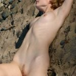 Teen Girl Relaxing Naked on the Sand