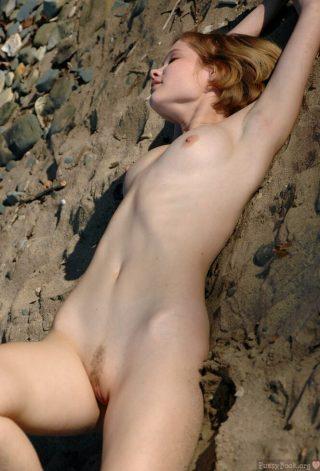 Teen Girl Relaxing Naked on the Sand