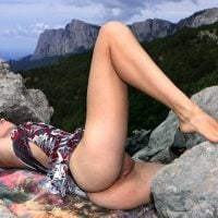 Bottomless Girl Exposing Pussy on the Rocks