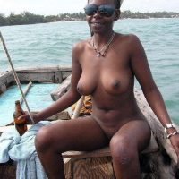 Ebony Nudist Woman on a Raft