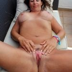 Naked Mother Spreading Her Shaved Cunt