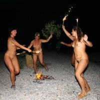 Group-of-Nudist-Women-Dancing-Naked-at-Campfire-HD