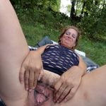 Mid Age Woman Spreading Vagina in the Nature