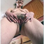 Naked Old Woman Opening Hairy Vagina from Below