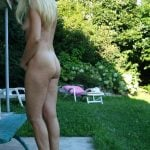 Italian exhibitionist woman naked in the yard Gallery