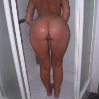 Bare Round Buttocks in Shower Cabin