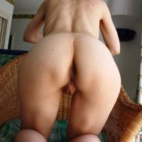 Bare Wife Bends Over on Chair