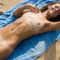 Beautiful Babe Nude on Beach Towel
