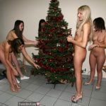 Group of Nude Girls Decorating Christmas Tree