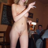 Nude Bartender Girl Serving Beer