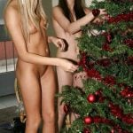 Nude Blonde and Brunette Girls Decorating Tree