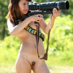 Nude Photographer Girl Shooting with Big Camera