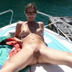 Nudist Woman on Motorboat Spreading Legs
