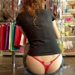 Red Thong Butt Crack in a store