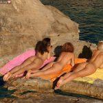 Three Nudist Teens Butts on Rocks