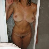 breasts-pressed-on-shower-cabin