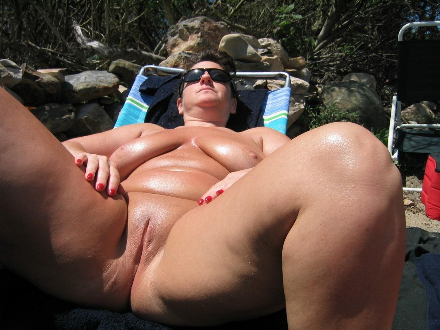 Nude fat lady sunbathing