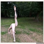 Flexible yoga Girl Nude outdoor in the wood