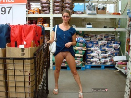 girl-flashing-her-small-cunt-in-store