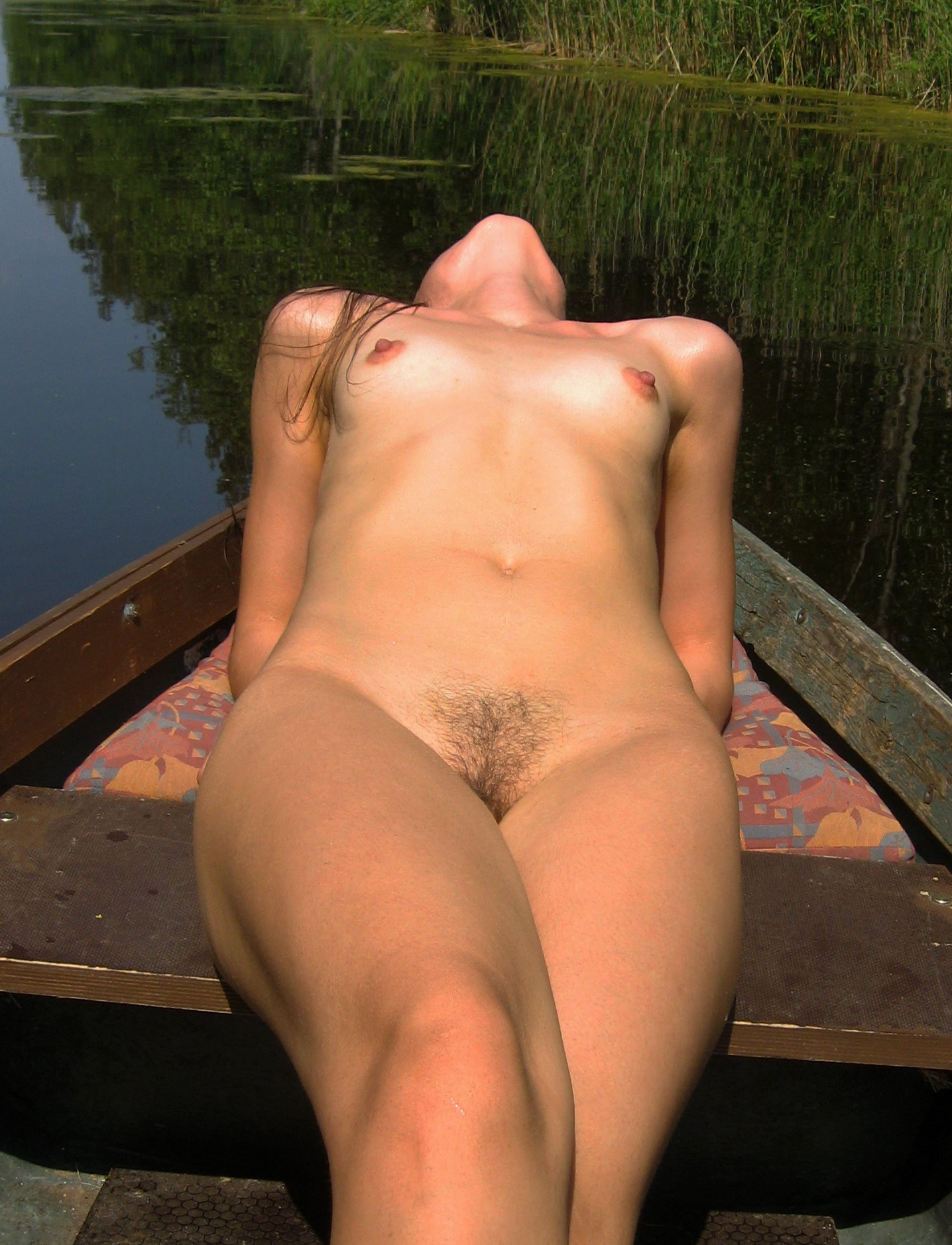 hot-girl-shows-boobs-in-boat