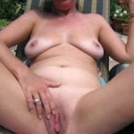 Lady's Pink Pussy Nudism in the yard