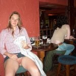 lift skirt to show cunt at the bar
