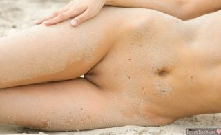 naked-dirty-female-belly-and-pussy-with-sand-on-beach