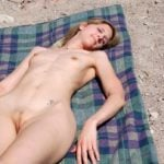 Naturalist Woman Sunbathing